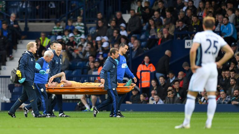 Tottenham defender Toby Alderweireld is stretchered off the pitch during the game at West Brom