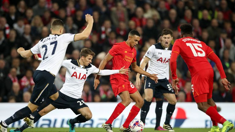 Liverpool's Trent Alexander-Arnold (centre) holds off Tottenham Hotspur's Tom Carroll (left) and Ben Davies (right) during the EFL Cup, round of 16 match a
