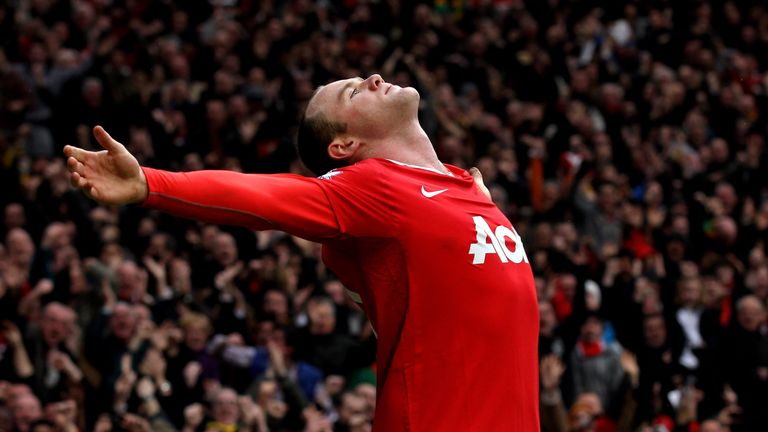 MANCHESTER, ENGLAND - FEBRUARY 12:  Wayne Rooney of Manchester United celebrates after he scores a goal from an overhead kick during the Barclays Premier L