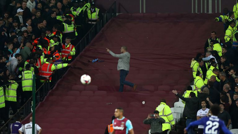 Chelsea and West Ham fans threw missiles across a segregated area