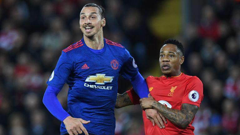 Liverpool defender Nathaniel Clyne (R) marks Manchester United striker Zlatan Ibrahimovic