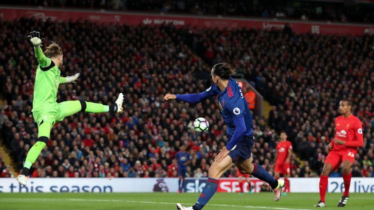 Manchester United's Zlatan Ibrahimovic (right) heads across goals