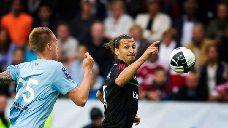 Malmo's Pontus Jansson runs after AC Milan's Zlatan Ibrahimovic during their friendly football match at the Swedbank Stadium in Malmo on August 14, 2011. A