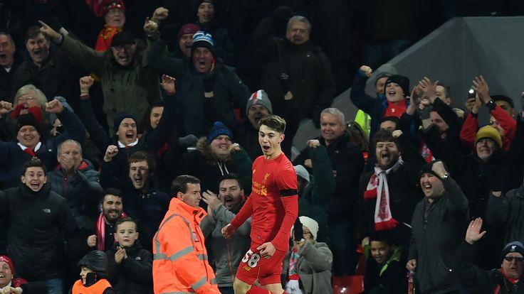 Liverpool's Welsh striker Ben Woodburn (L) celebrates scoring his team's second goal during the EFL (English Football League) Cup quarter-final football ma