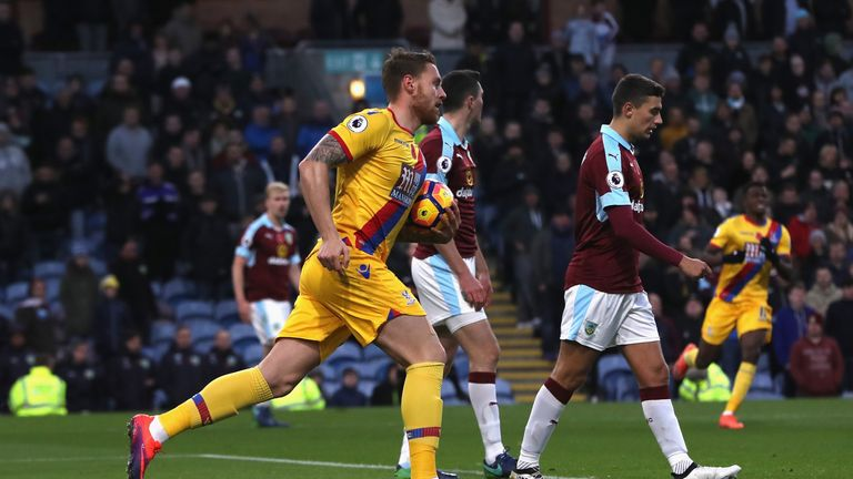 Crystal Palace striker Connor Wickham races away after scoring with his first touch against Burnley