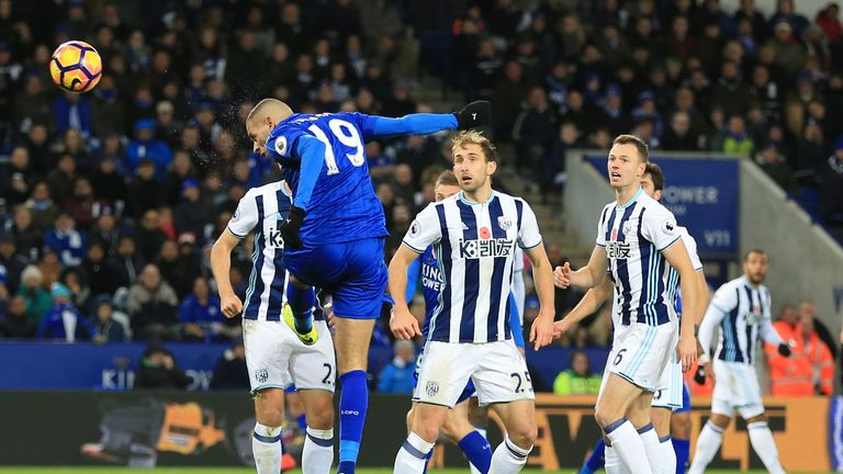 Leicester City's Islam Slimani (left) scores his team's first goal of the game during the Premier League match v West Brom at the King Power Stadium