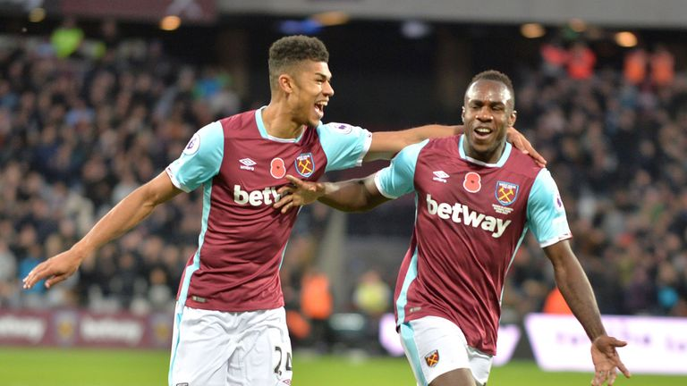 Michail Antonio (R) celebrates with Ashley Fletcher after scoring the opening goal in West Ham v Stoke, Premier League