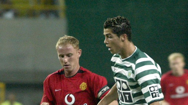 Cristiano Ronaldo takes on Nicky Butt in action for Sporting Lisbon against Manchester United in 2003