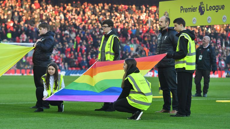 A rainbow flag is presented on the pitch before the Premier League match v Sunderland at Anfield, Liverpool, as part of the Rainbow Laces campaign