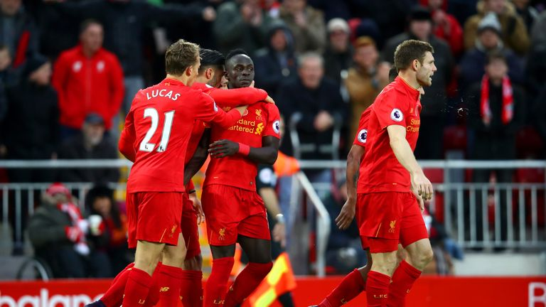 Sadio Mane of Liverpool celebrates scoring his second and his side's fifth goal with team-mates during the Premier League match v Watford