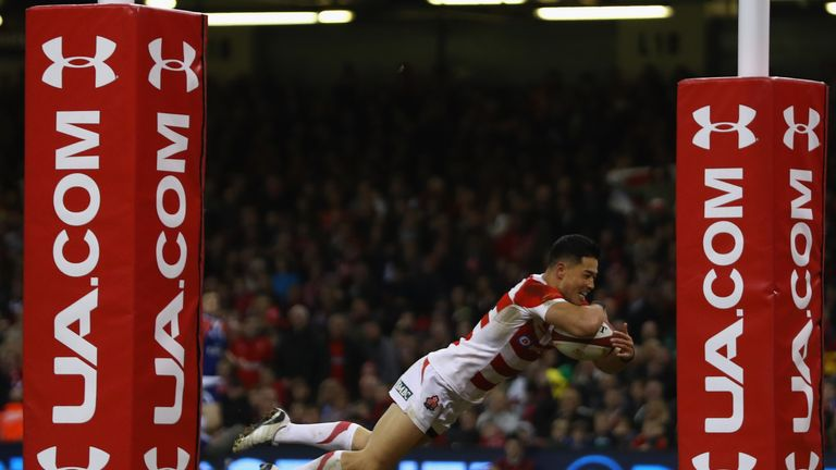 Akihito Yamada of Japan scores his side's first-half try
