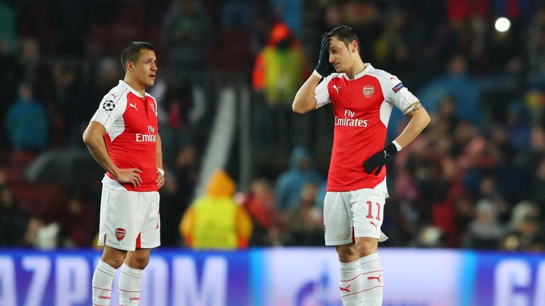 BARCELONA, SPAIN - MARCH 16: Alexis Sanchez (L) and Mesut Ozil (R) of Arsenal show their dejection after Barcelona's first goal during the UEFA Champions L