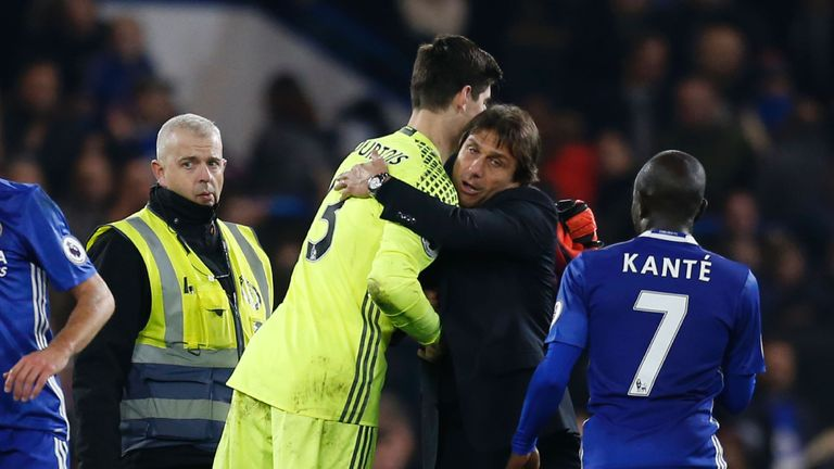 Chelsea's Thibaut Courtois (L) is hugged by head coach Antonio Conte