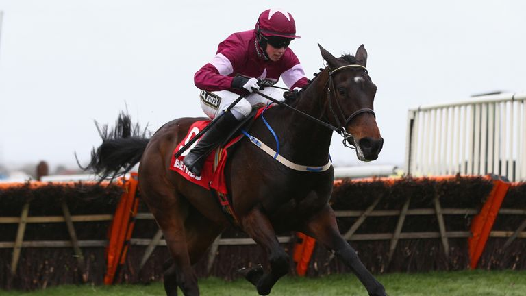 Bryan Cooper on his way to victory on Apple'sJade in the Betfred Anniversry Juvenile hurdle race at Aintree