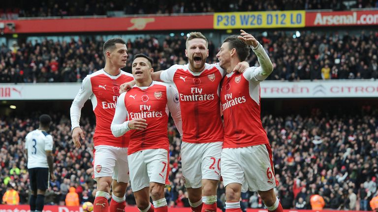 Arsenal players celebrate after Kevin Wimmer's own goal at the Emirates