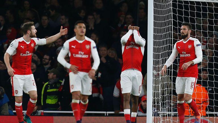 Arsenal's Nigerian striker Alex Iwobi (2R) reacts after deflecting the ball from Paris Saint-Germain's Brazilian midfielder Lucas Moura's header for Paris'