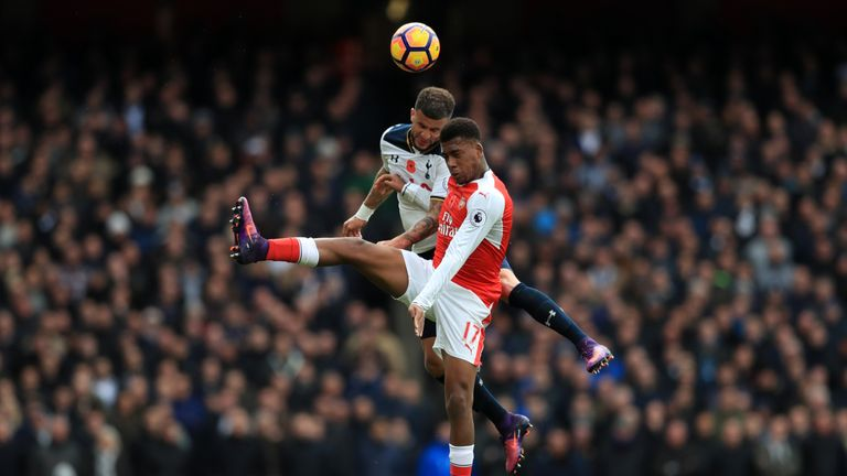 Tottenham Hotspur's Kyle Walker and Arsenal's Alex Iwobi battle for the ball in the air