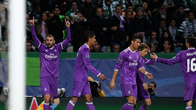 Real Madrid's French forward Karim Benzema (L) celebrates after scoring a goal during the UEFA Champions League football match Sporting CP vs Real Madrid C
