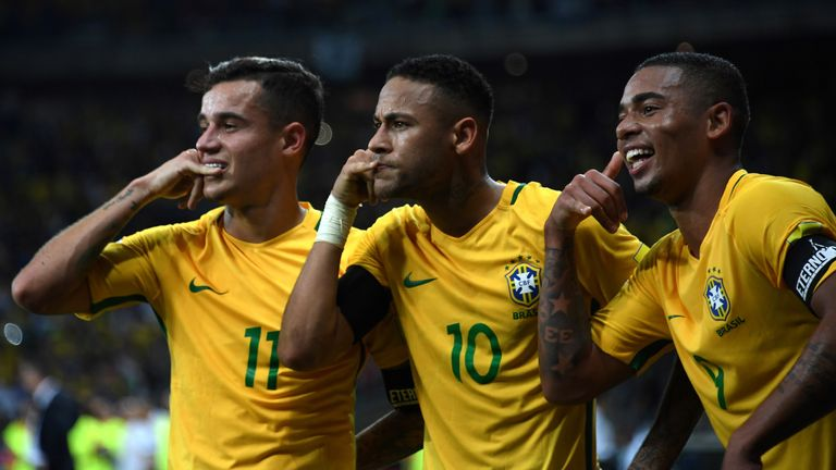 Neymar (C) enjoying his night alongside Philippe Coutinho (L) and Gabriel Jesus against Argentina