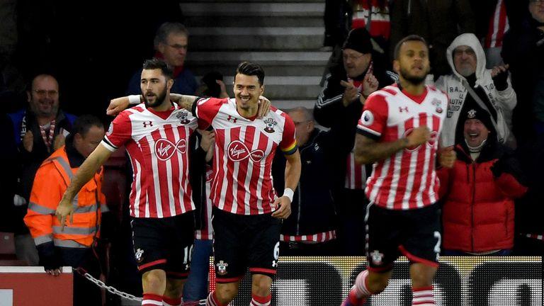 SOUTHAMPTON, ENGLAND - NOVEMBER 27: Charlie Austin of Southampton (L) celebrates scoring his sides first goal with Jose Fonte of Southampton (C) during the