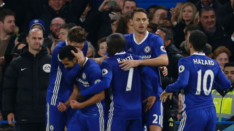 Chelsea midfielder Pedro (2L) celebrates scoring their first goal to equalise