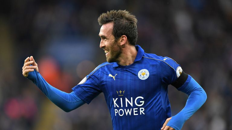 LEICESTER, ENGLAND - OCTOBER 22:  Christian Fuchs of Leicester City celebrates scoring his sides third goal during the Premier League match between Leicest