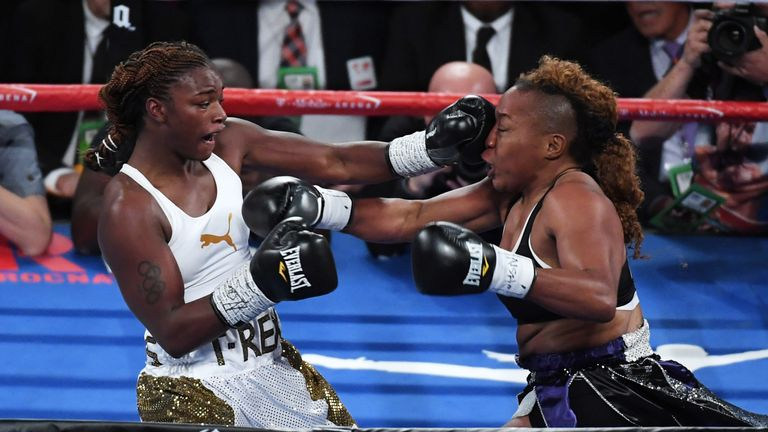 Claressa Shields (L) hits Franchon Crews with a left in the second round of their super middleweight bout at T-Mobile Arena