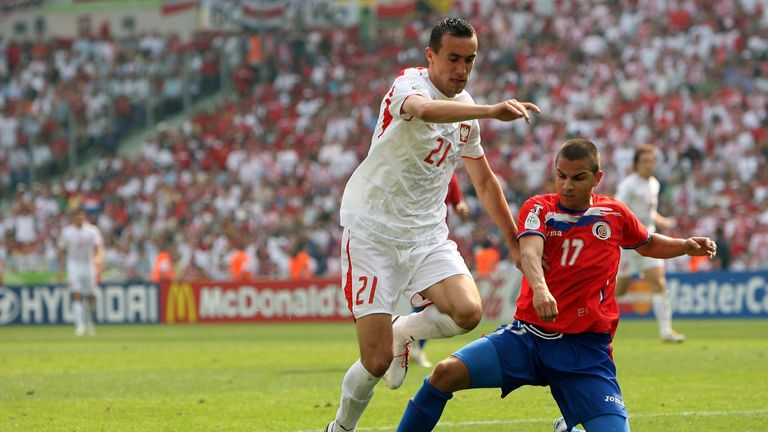 HANOVER, GERMANY - JUNE 20: Irenuesz Jelen of Poland is tackled by Gabriel Badilla of Costa Rica during the FIFA World Cup Germany 2006 match between Costa