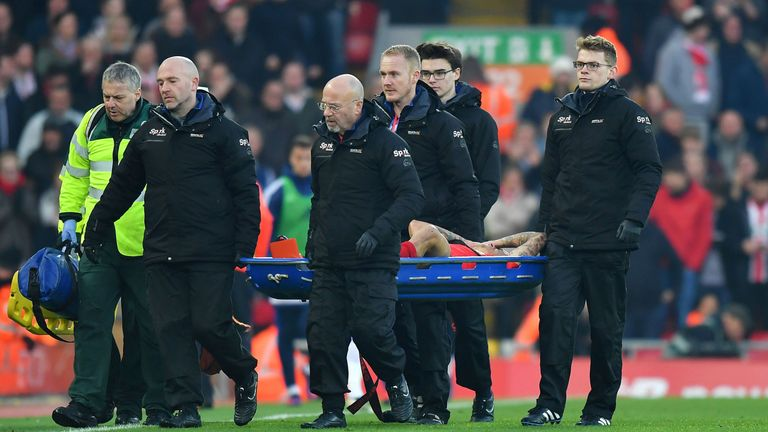 Liverpool's Philippe Coutinho is carried off after being injured