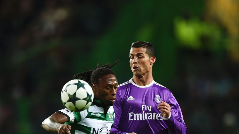 Real Madrid's Portuguese forward Cristiano Ronaldo (R) vies with Sporting's defender Ruben Semedo (L) during the UEFA Champions League football match Sport