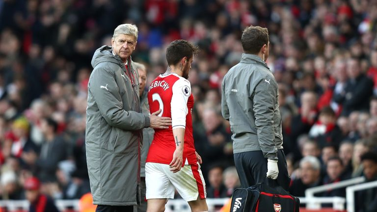Mathieu Debuchy was substituted just 15 minutes into is Arsenal return
