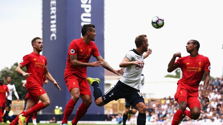 Dejan Lovren and Joel Matip defend against Harry Kane during Tottenham v Liverpool