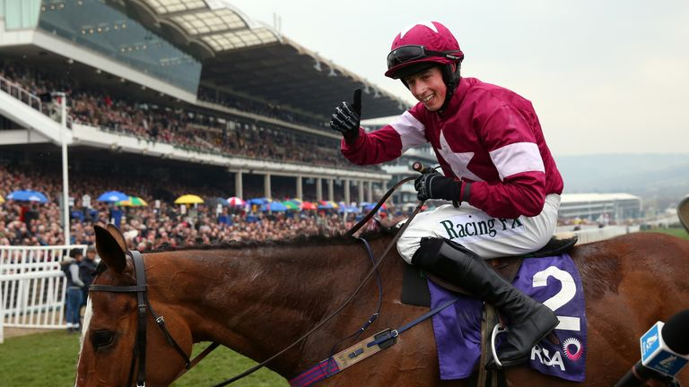 Bryan J. Cooper celebrates on Don Poli after they win the RSA Chase