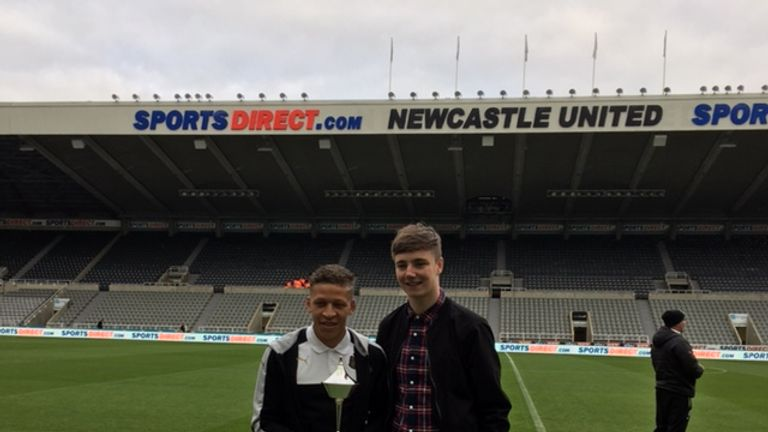 Newcastle striker Dwight Gayle is presented with October's Championship award by Michael Cantwell