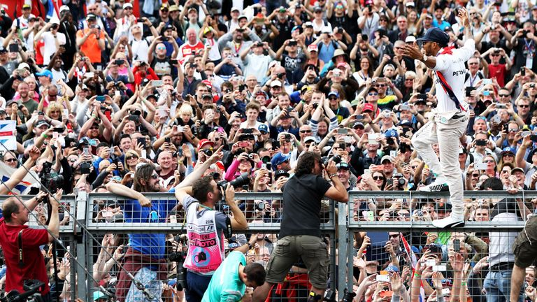 Lewis Hamilton celebrates with the Silverstone crowd after his British GP victory - Picture from Getty Images