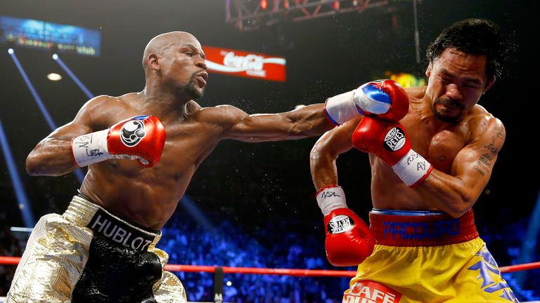 Floyd Mayweather Jr. throws a left at Manny Pacquiao during their welterweight unification championship bout on May 2, 2015 at MGM