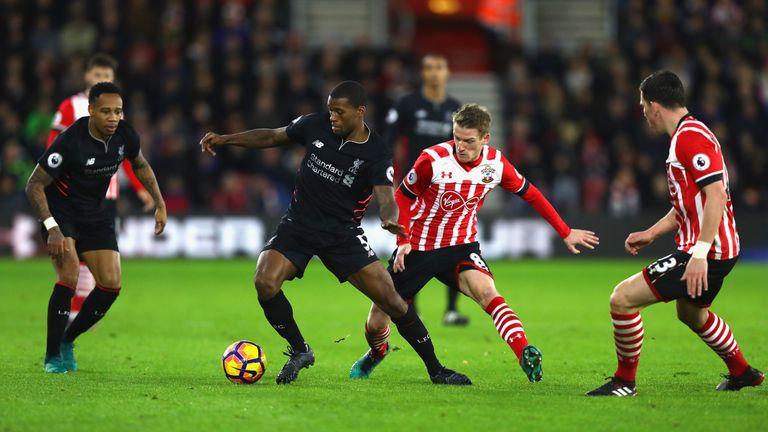 SOUTHAMPTON, ENGLAND - NOVEMBER 19: Georginio Wijnaldum of Liverpool (CL) is put under pressure from Steven Davis of Southampton (CR) during the Premier Le