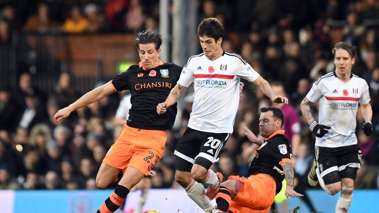 Fulham's Lucas Piazon (centre) battles with Sheffield Wednesday's Sam Hutchinson