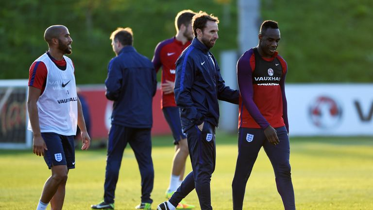 BURTON-UPON-TRENT, ENGLAND - OCTOBER 04:  Interim England manager Gareth Southgate speaks with Michail Antonio during an England training session at St Geo