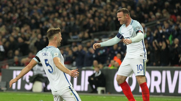 England's defender Gary Cahill (L) celebrates with England's striker Wayne Rooney after scoring their third goal during a World Cup 2018 qualification matc