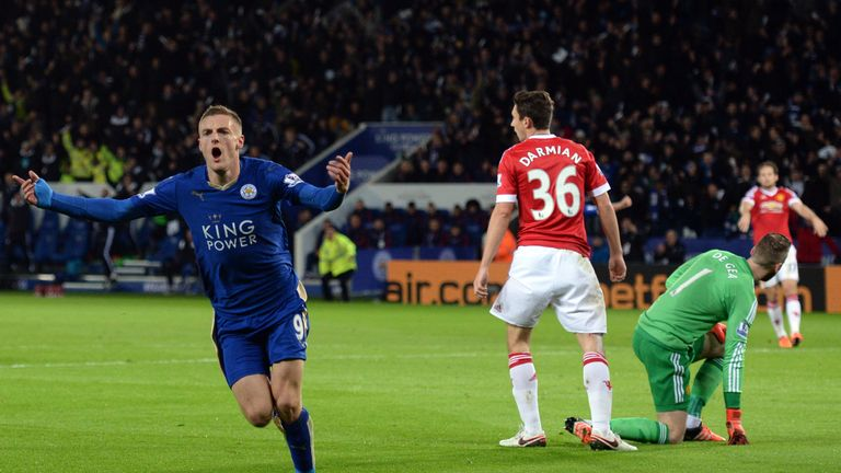 Vardy (L) celebrates after breaking the consecutive goals record in November 2015