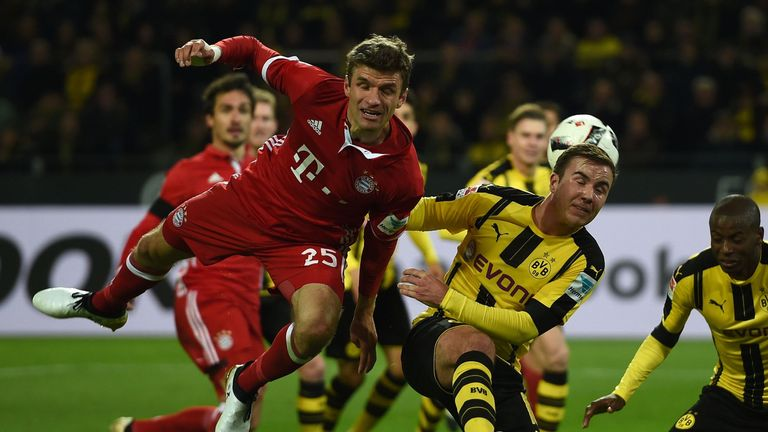 Muller (L) challenges Mario Gotze (R) for the ball