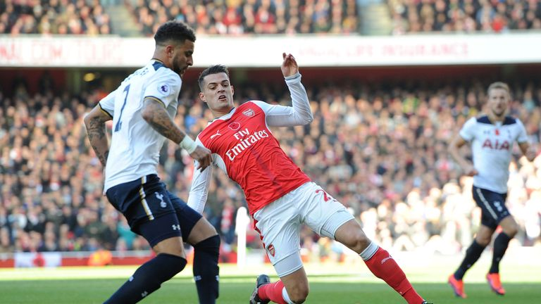 Granit Xhaka tackles Kyle Walker during Arsenal's 1-1 draw with Tottenahm