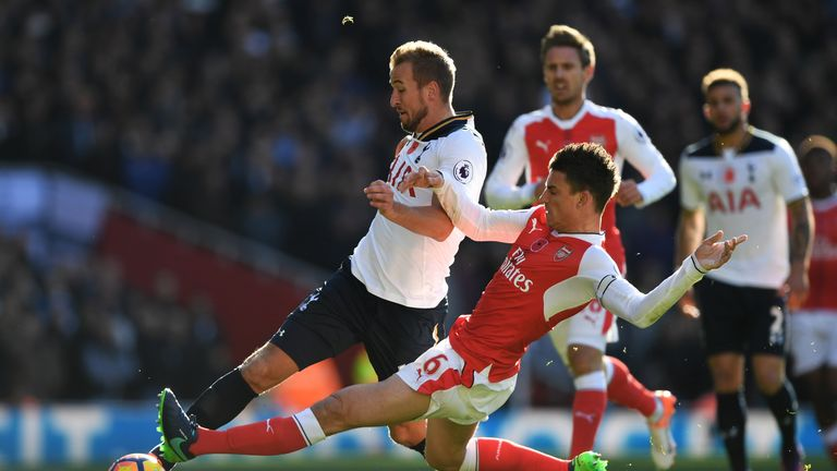 LONDON, ENGLAND - NOVEMBER 06:  Laurent Koscielny of Arsenal and Harry Kane of Tottenham Hotspur battle for possession during the Premier League match betw