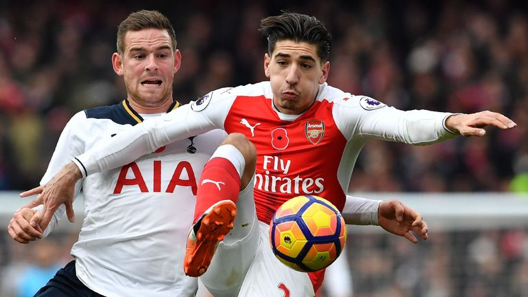 Vincent Janssen battles for posession with Hector Bellerin at the Emirates Stadium
