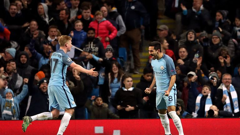 Manchester City's Ilkay Gundogan celebrates scoring his side's third goal of the game with Kevin De Bruyne (left) during the UEFA Champions League match at