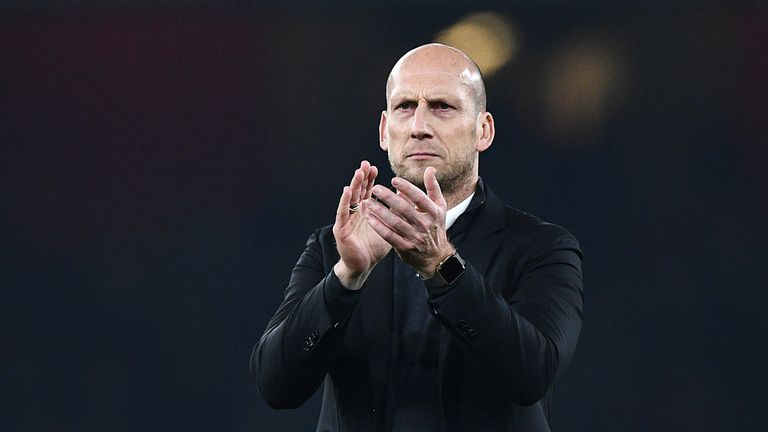 Reading's Dutch manager Jaap Stam applauds supporters after the EFL (English Football League) Cup fourth round match between Arsenal and Reading at The Emi