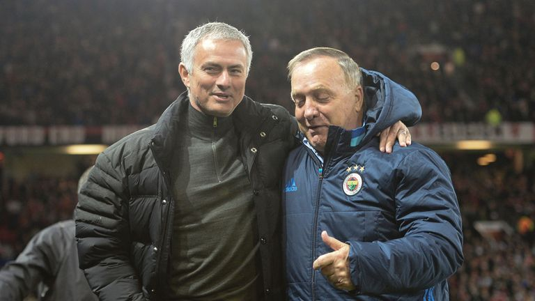 Manchester United's Portuguese manager Jose Mourinho (L) greets Fenerbahce's Dutch coach Dick Advocaat (R) during the UEFA Europa League group A match