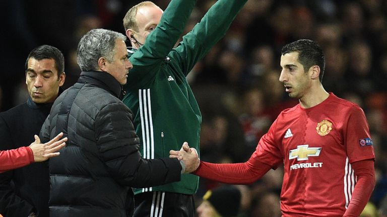 Manchester United's Armenian midfielder Henrikh Mkhitaryan (R) shakes hands with Manchester United's Portuguese manager Jose Mourinho (L) as he is substitu
