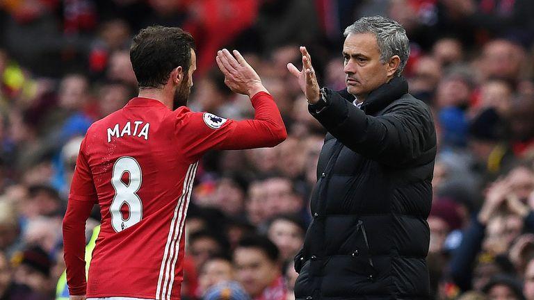 Jose Mourinho congratulates Juan Mata as leaves the pitch